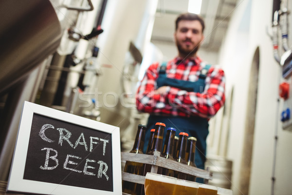 Craft beer sign with manufacturer in brewery Stock photo © wavebreak_media