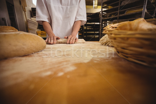 Mid-section of female baker kneading a dough Stock photo © wavebreak_media