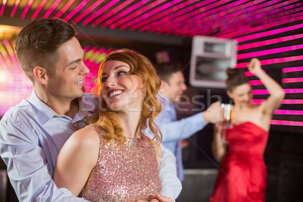 Cute couple danse ensemble piste de danse bar Photo stock © wavebreak_media