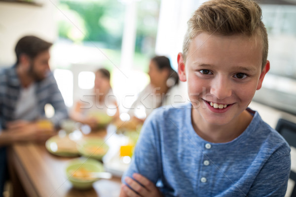 Portrait of boy sitting on dining table Stock photo © wavebreak_media