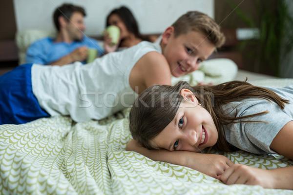 Family lying on bed in bedroom Stock photo © wavebreak_media