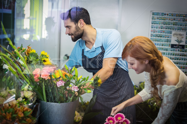 Couple arranging flower bouquet Stock photo © wavebreak_media