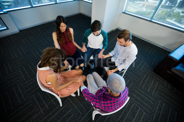 Creative business team holding each others hand at office Stock photo © wavebreak_media
