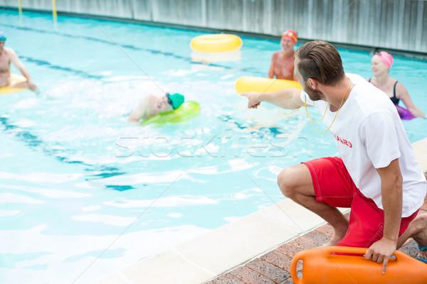 lifeguard assisting swimmers at poolside Stock photo © wavebreak_media
