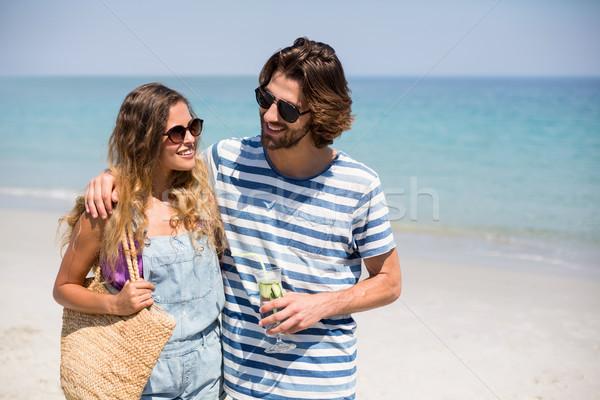 Happy couple standing on shore Stock photo © wavebreak_media