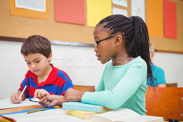 Stock photo: Student helping fellow student in class