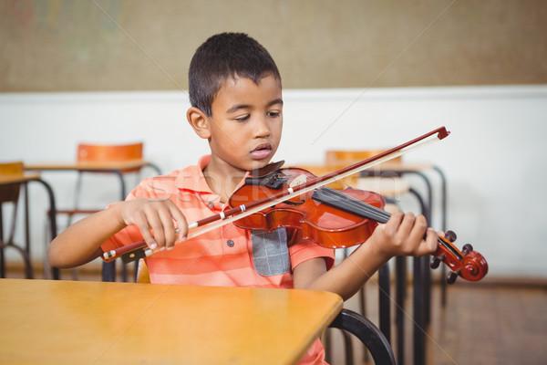 Student using a violin in class Stock photo © wavebreak_media