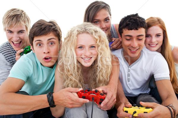 Eccitato adolescenti giocare videogiochi soggiorno Foto d'archivio © wavebreak_media