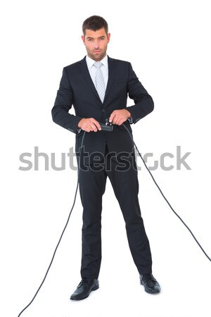 Enthusiastic businessman standing with folded arms  Stock photo © wavebreak_media