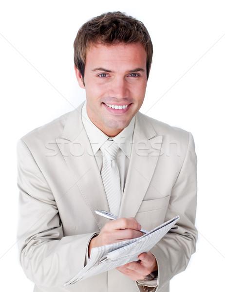 Smiling caucasian businessman holding a newspaper  Stock photo © wavebreak_media