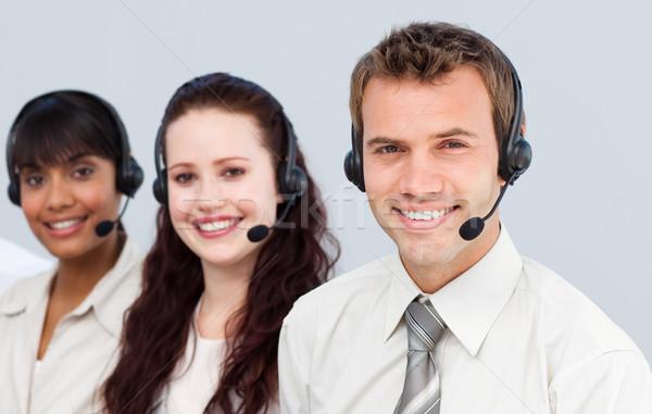 年輕 團隊 耳機 工作的 呼叫中心 微笑 商業照片 © wavebreak_media