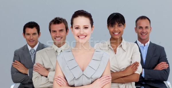 Equipe de negócios dobrado brasão sorridente negócio Foto stock © wavebreak_media