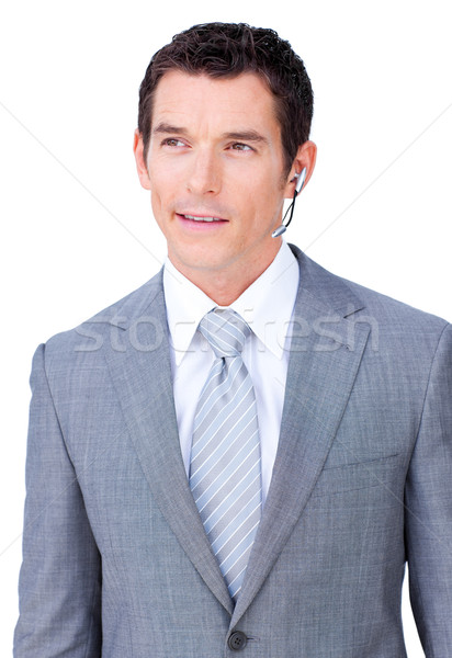 Self-assured male executive with headset on  Stock photo © wavebreak_media
