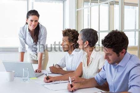 Tolakodó üzlet munkatársak megbeszélés iroda számítógép Stock fotó © wavebreak_media