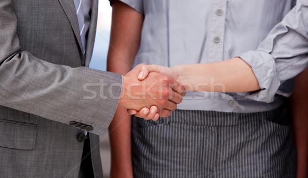 Close-up of a lucky businessteam closing a deal Stock photo © wavebreak_media