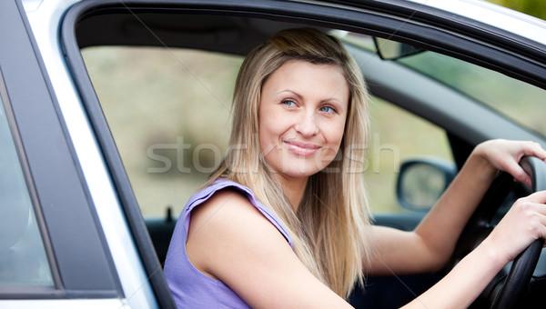Chaming female driver at the wheel  Stock photo © wavebreak_media