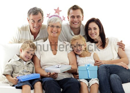 Big family on sofa holding a terrestrial globe Stock photo © wavebreak_media