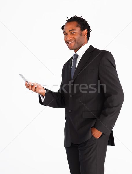 Serious businessman sending text message Stock photo © wavebreak_media