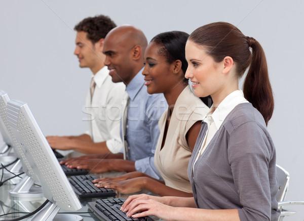 Komoly nemzetközi üzlet csapat dolgozik számítógépek iroda Stock fotó © wavebreak_media