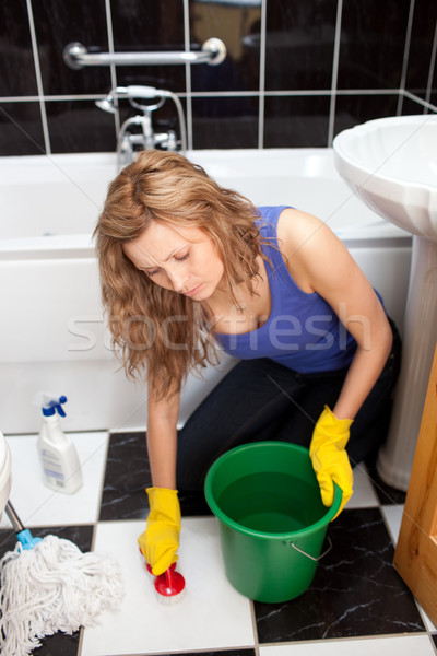 Unhappy woman cleaning the ground of a bathroom Stock photo © wavebreak_media
