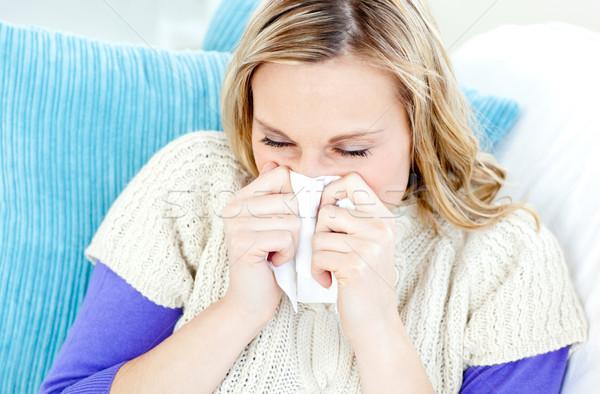 Beteges nő papírzsebkendő ül kanapé otthon Stock fotó © wavebreak_media