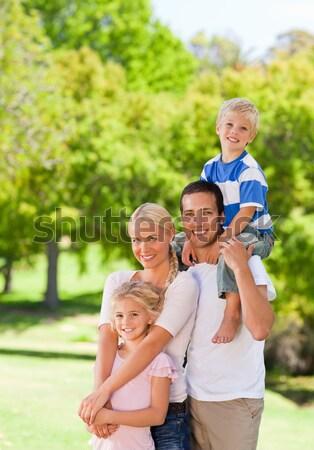 Szülők gyerekek háton park nő család Stock fotó © wavebreak_media