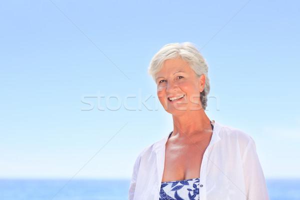Portré idős nő tengerpart boldog homok Stock fotó © wavebreak_media