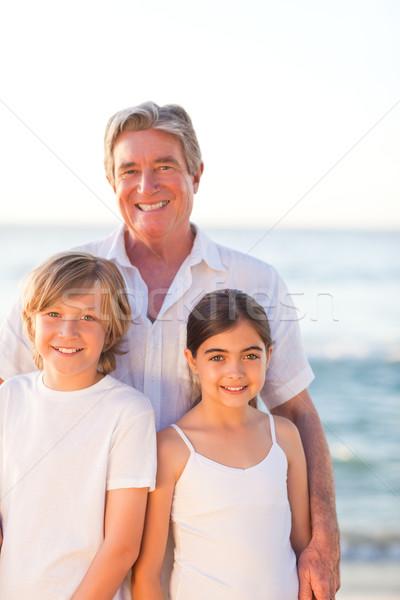 Zdjęcia stock: Portret · dziadek · wnuki · plaży · niebo · wody
