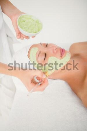 Ritratto felice donna olio da massaggio indietro fiori Foto d'archivio © wavebreak_media