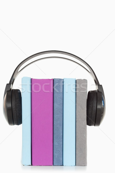 A stack of books and headphones against a white background Stock photo © wavebreak_media