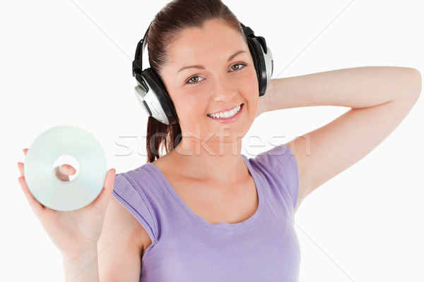 Kobieta słuchawki płyta cd stałego Zdjęcia stock © wavebreak_media