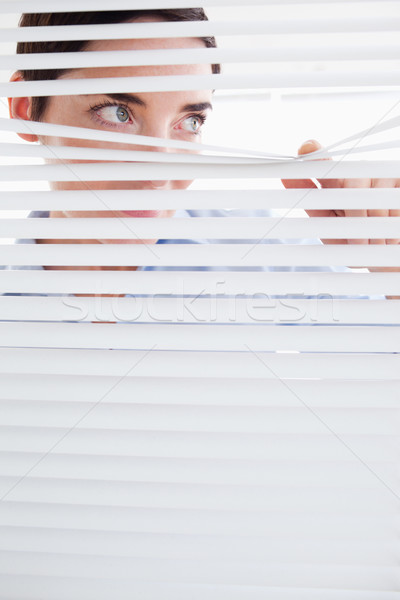 Kíváncsi barna hajú nő ki ablak iroda Stock fotó © wavebreak_media