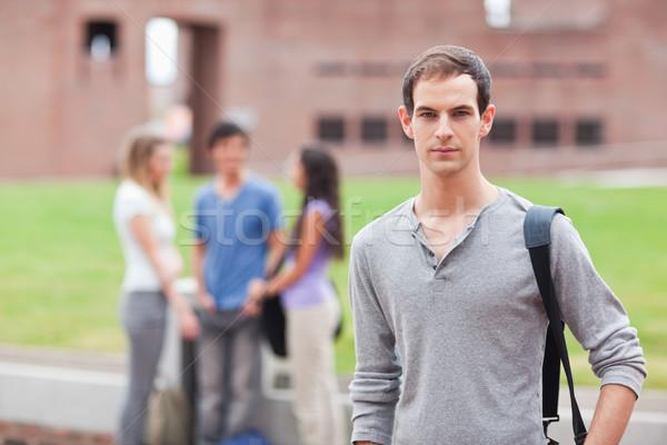 Férfi diák pózol osztálytársak beszél fal Stock fotó © wavebreak_media