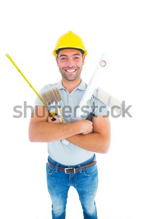 Portrait of a young builder making a phone call against a white background Stock photo © wavebreak_media