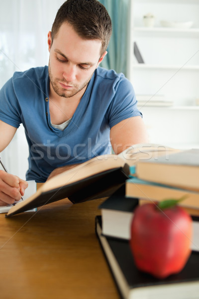 Male student doing his assignment Stock photo © wavebreak_media