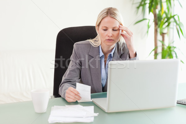 Worried businesswoman checking a bill Stock photo © wavebreak_media