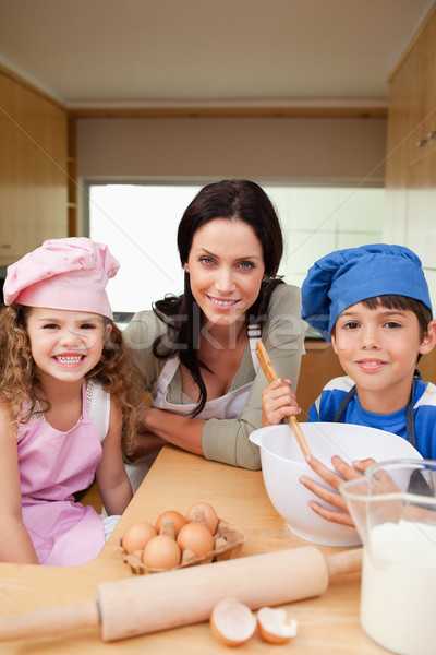 Mother and her children preparing dough together Stock photo © wavebreak_media