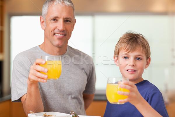 мальчика отец завтрак кухне дома улыбка Сток-фото © wavebreak_media