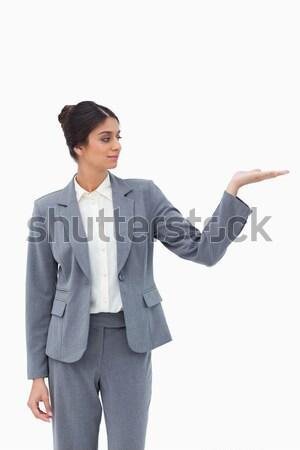 Businesswoman pointing upwards against a white background Stock photo © wavebreak_media