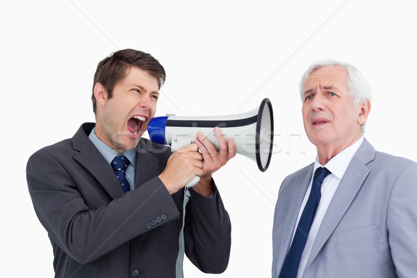 Close up of businessman with megaphone yelling at his boss against a white background Stock photo © wavebreak_media