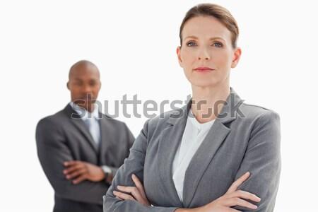 Сток-фото: деловая · женщина · сложенный · оружия · стоять · бизнесмен · рук