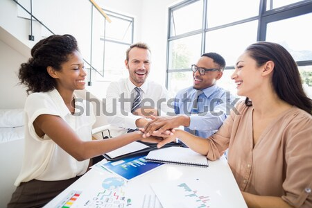 Handshake between a businesswoman and a co-worker when a meeting is ending Stock photo © wavebreak_media