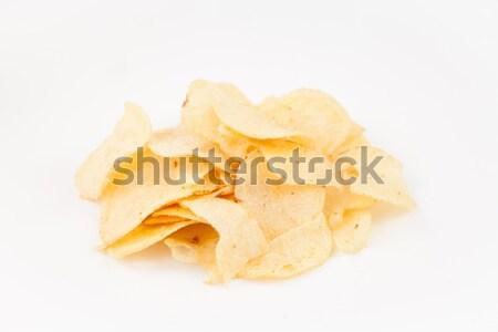 Stack of chips against white background Stock photo © wavebreak_media