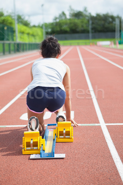 Woman at starting blocks on track field  Stock photo © wavebreak_media