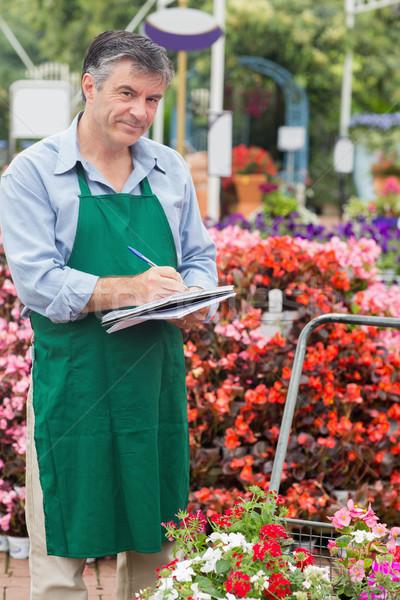 Assistant taking notes in garden center Stock photo © wavebreak_media