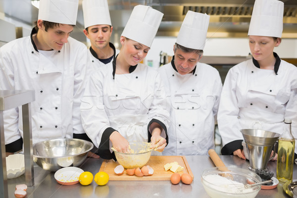 Pastry chef showing students how to prepare dough in kitchen Stock photo © wavebreak_media