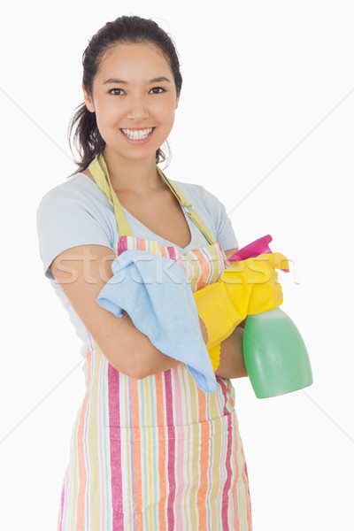 Happy woman holding spray bottle and rag in apron and rubber gloves Stock photo © wavebreak_media