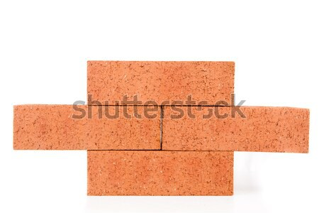 óvatosan egymásra pakolva piros téglák Stock fotó © wavebreak_media