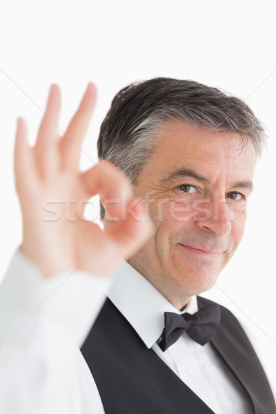 Smiling waiter making ok sign to the camera Stock photo © wavebreak_media