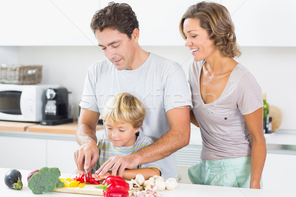 Mother watching father teaching son to chop vegetables Stock photo © wavebreak_media